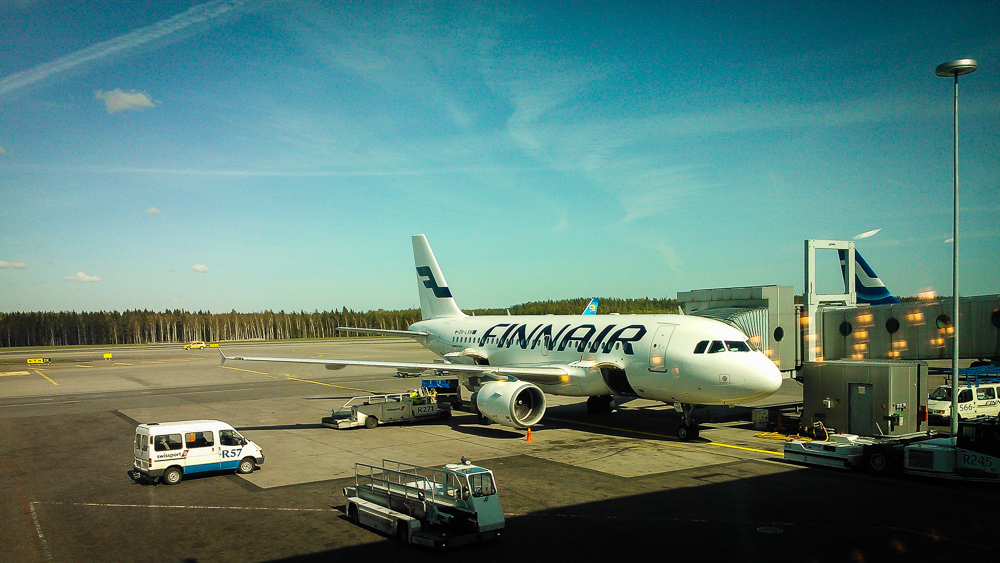 Finnair plane loading at Helsinki airport