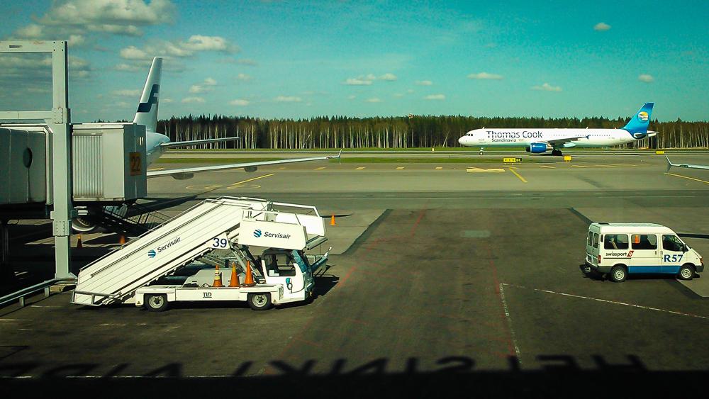 Thomas Cook plane landing at Helsinki Airport