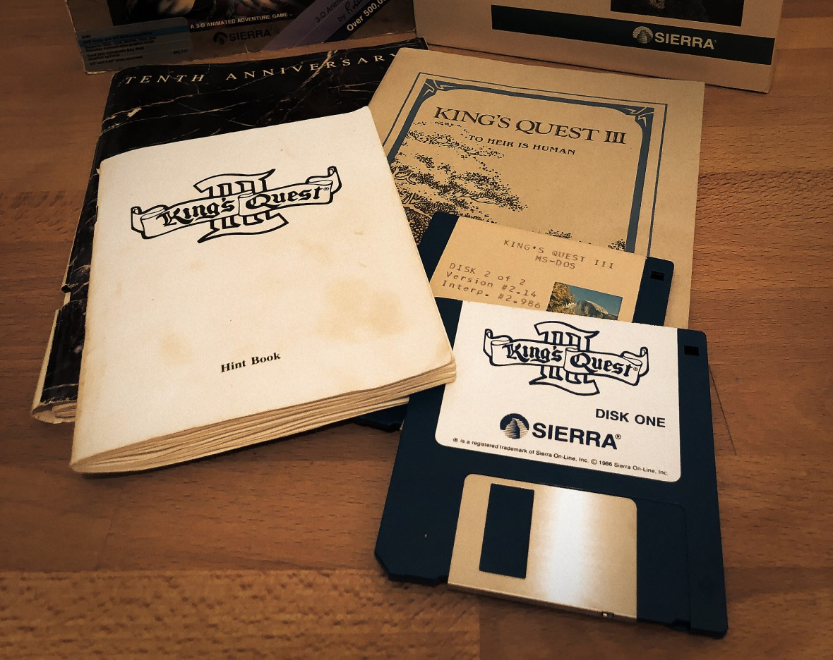 King's Quest II diskettes, hint book and manual on a desk